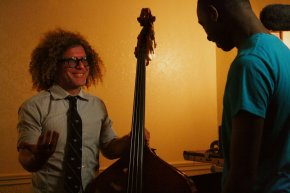 Ben Jaffe, imaginative director for the Preservation Hall Jazz Band, offers Justin, fifteen, a lesson regarding the bass.